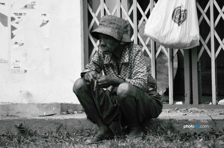beggar-sitting-by-the-roadside